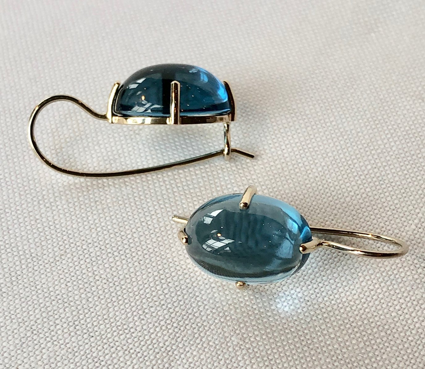 Cabochon Oval Earrings with Light Blue Topaz Stone