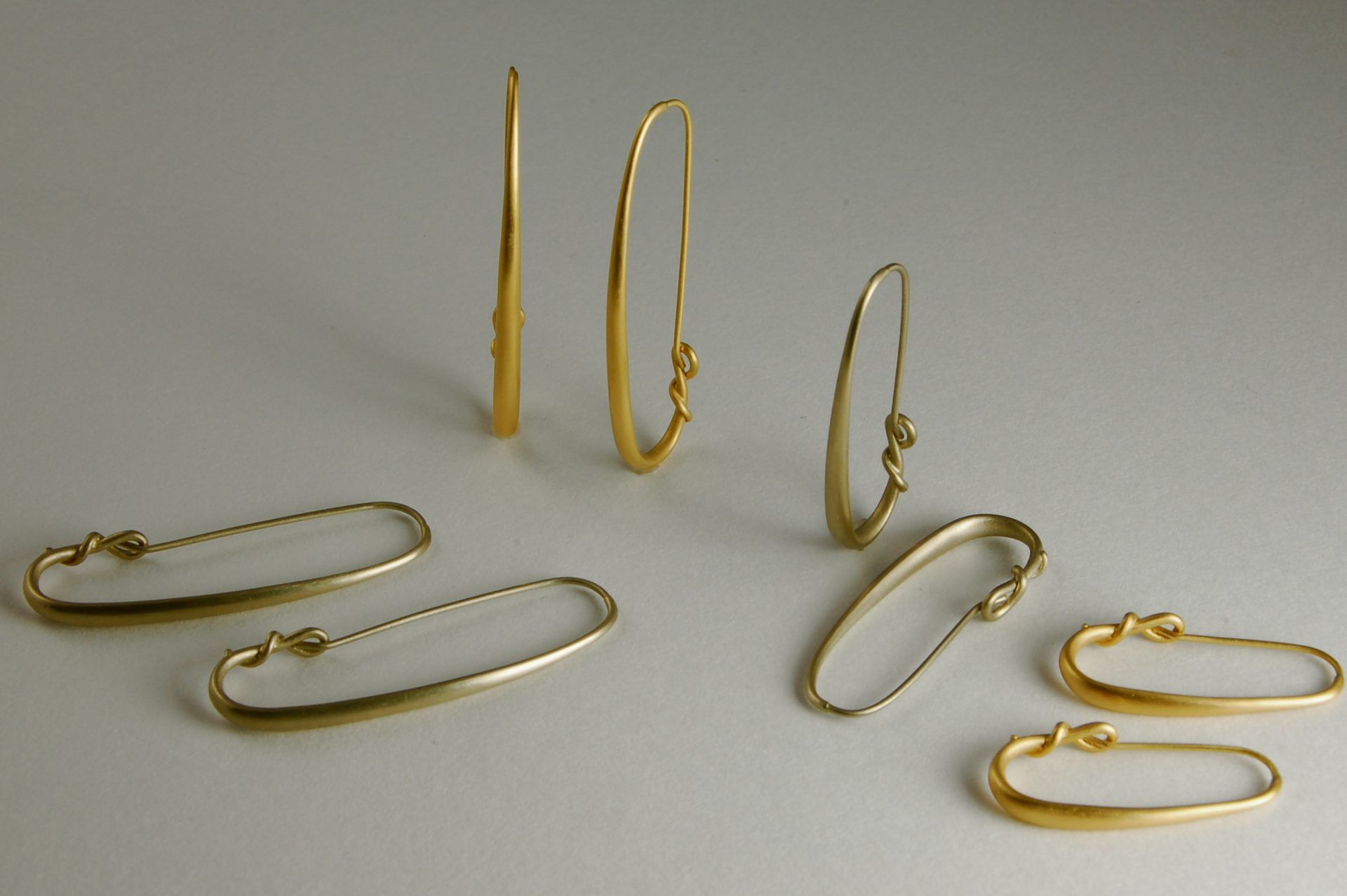 Large and Small Eclipse Hoop Earrings in Yellow and White Gold